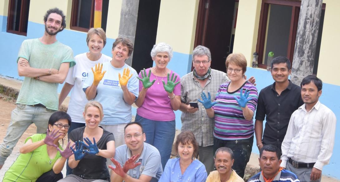A group of Grown-up Special volunteers finish painting